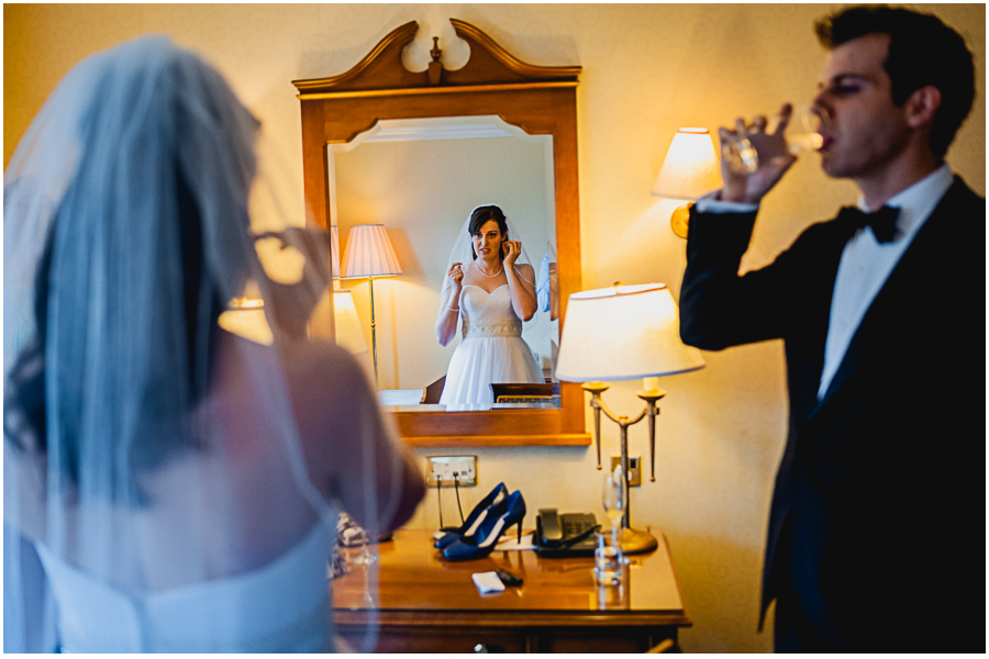 wedding photographer Windsor, bride are browsing in a mirror,