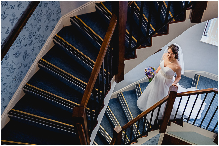wedding photographer Windsor, bride walking down the stairs