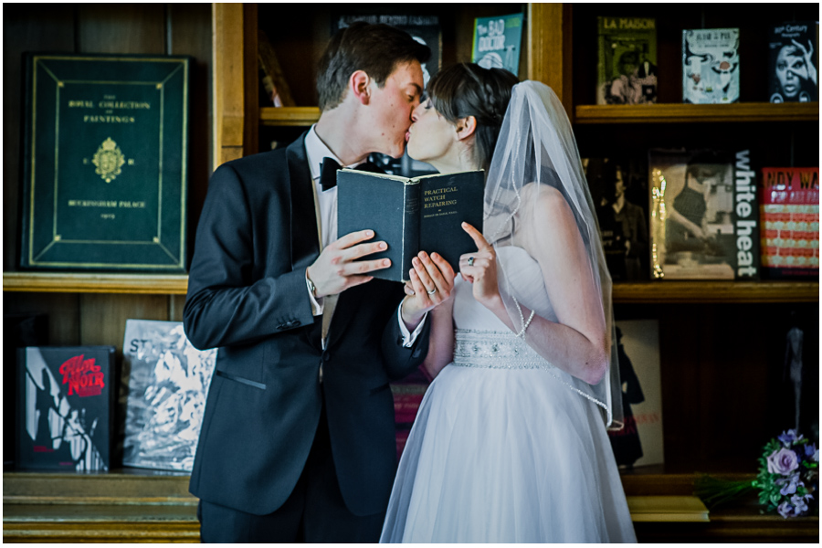 wedding photographer Windsor, kissing wedding couple in the library